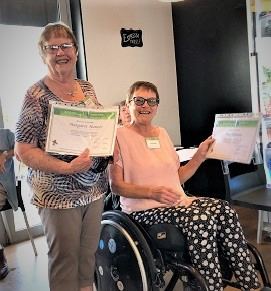 margaret hunter and Ava Thomas getting their life membership.Certificate